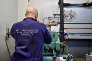 Welch Refrigeration team fixing heating and air conditioning system. Experts in Air Conditioning Ipswich.