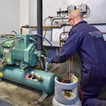Welch Refrigeration engineer servicing an air conditioning system