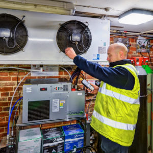 Welch Refrigeration Engineer Servicing A Cellar Cooling System In Essex